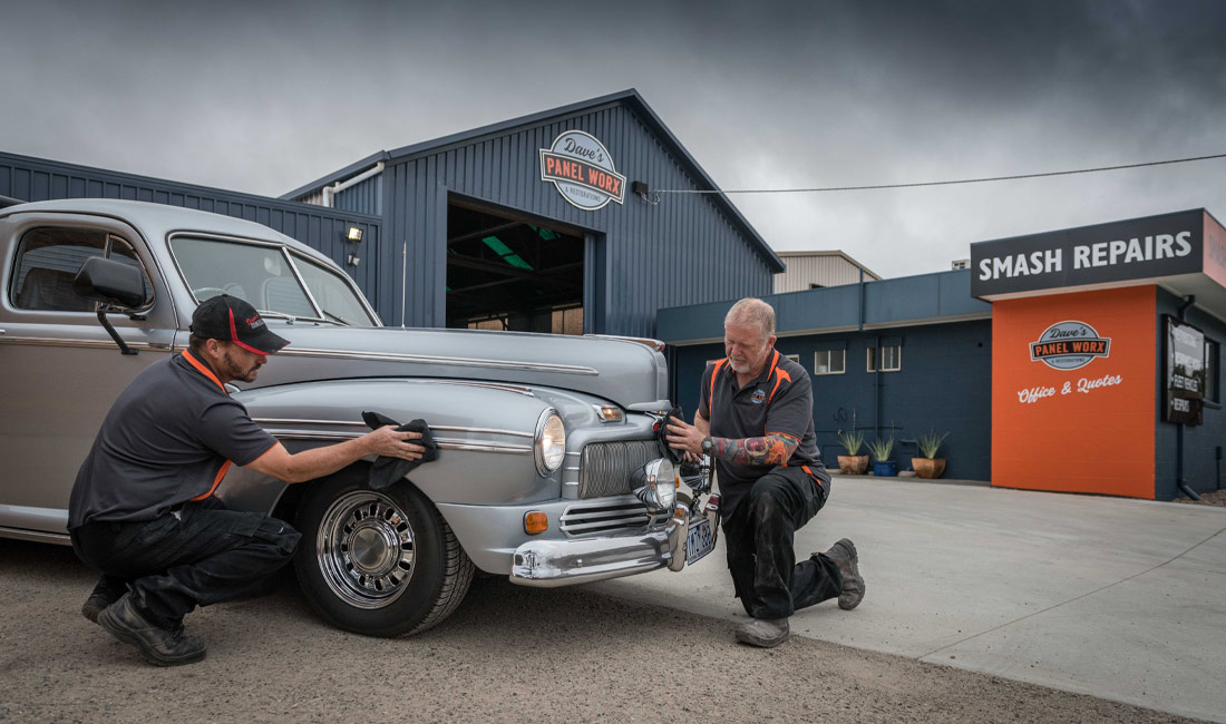 Dave and Troy polishing a classic silver Cheverolete ute